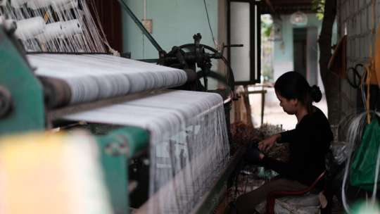 Woman working on a textile machine 2892373